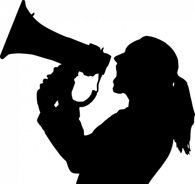 Stock picture of someone talking into a megaphone