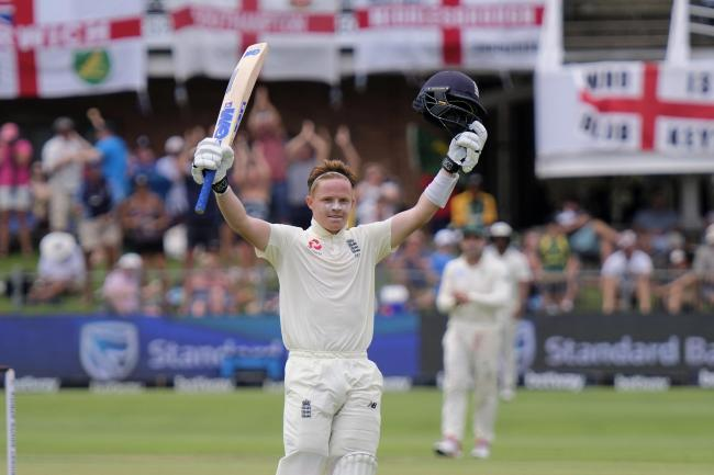 England's Ollie Pope celebrates making his hundred on day two