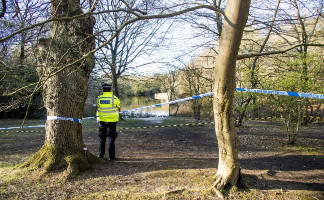 Police have set up a cordon around the pond in Epping Forest where a body was found