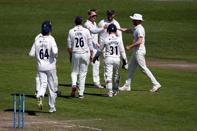 Well done - Essex's Simon Harmer celebrates with his team mates after taking the wicket of Ed Barnard Picture: GAVIN ELLIS