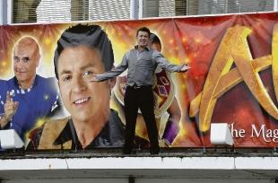 Billboard star – Shane Richie climbs up on the front of the Cliffs Pavilion, Westcliff,  where he will appear in December
