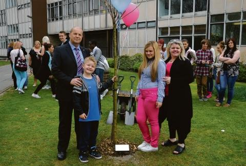 The Darling family with her commemorative tree
