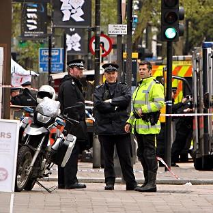 Tottenham Court Road in central London was closed after reports a man wearing gas canisters threatened to blow himself up