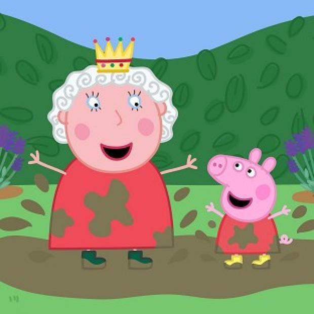 The Queen joins Peppa Pig jumping in muddy puddles