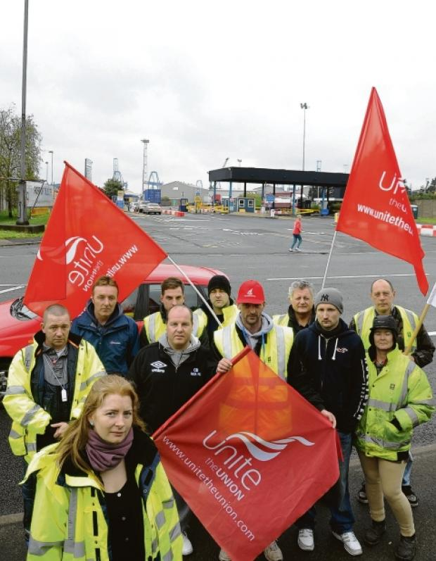 Dockers outside Tilbury Port with Unite's Jane Jeffrey.