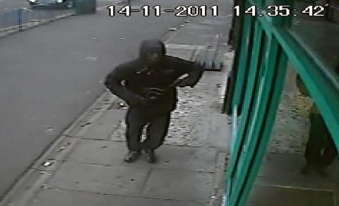 Temidire Owolabi enters the cafe armed with a gun