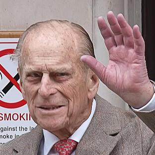 The Duke of Edinburgh waves as he leaves King Edward VII Hospital in central London