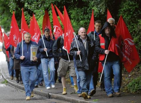 Workers demonstrate on Tuesday