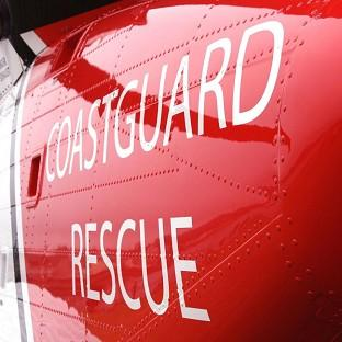 Coastguards are searching for the body of a four-year-old boy who entered the water at Burnham-on-Sea