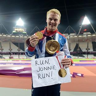 Great Britain's Jonnie Peacock celebrates with his gold medal in the men's 100m T44 final