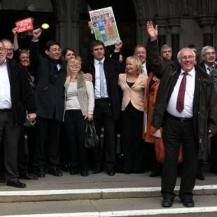 Hillsborough victims' families and supporters react after the High Court quashed the original accidental death inquest verdicts