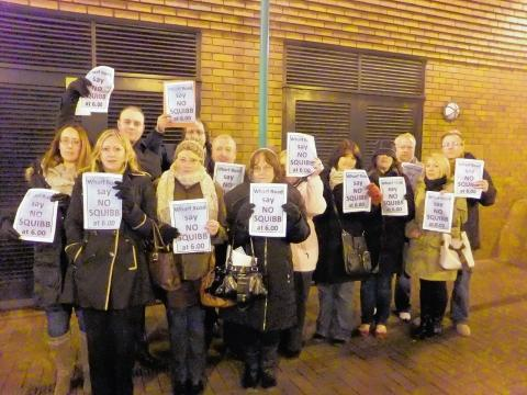 Residents protest outside the meeting