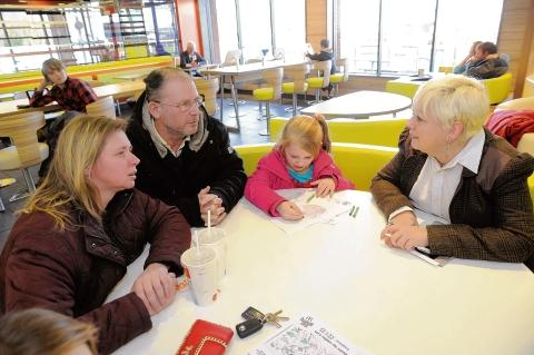 Thurrock Gazette: Jackie Doyle-Price MP talking to the Glidewell family at McDonald's