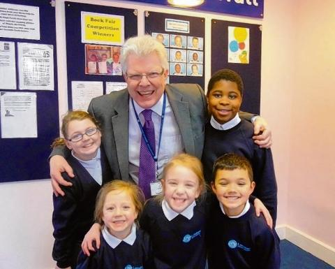 Richard Epps celebrates the good news with pupils