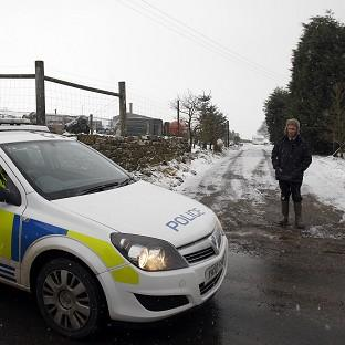 Police outside a meat processing plant in Todmorden, West Yorkshire, that was raided as part of the inquiry into the horse meat scandal