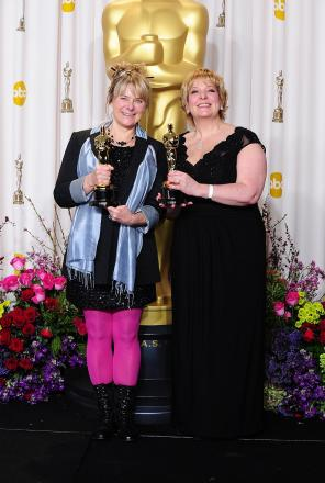 Julie Dartnell (right) with Lisa Westcott and their Oscar statuettes [PA]
