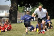 Sir Steve Redgrave races towards pupil Harley Tinnams.