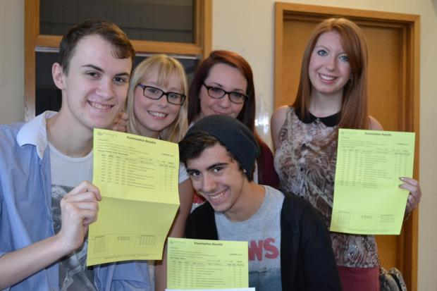 Smiles on A-Level results day! Students at Palmers College with their results