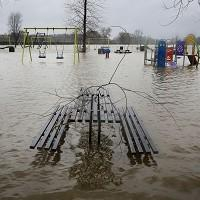 Thurrock Gazette: A children's play park covered by flood waters on the Racecourse Sportsground in Tonbridge, Kent.