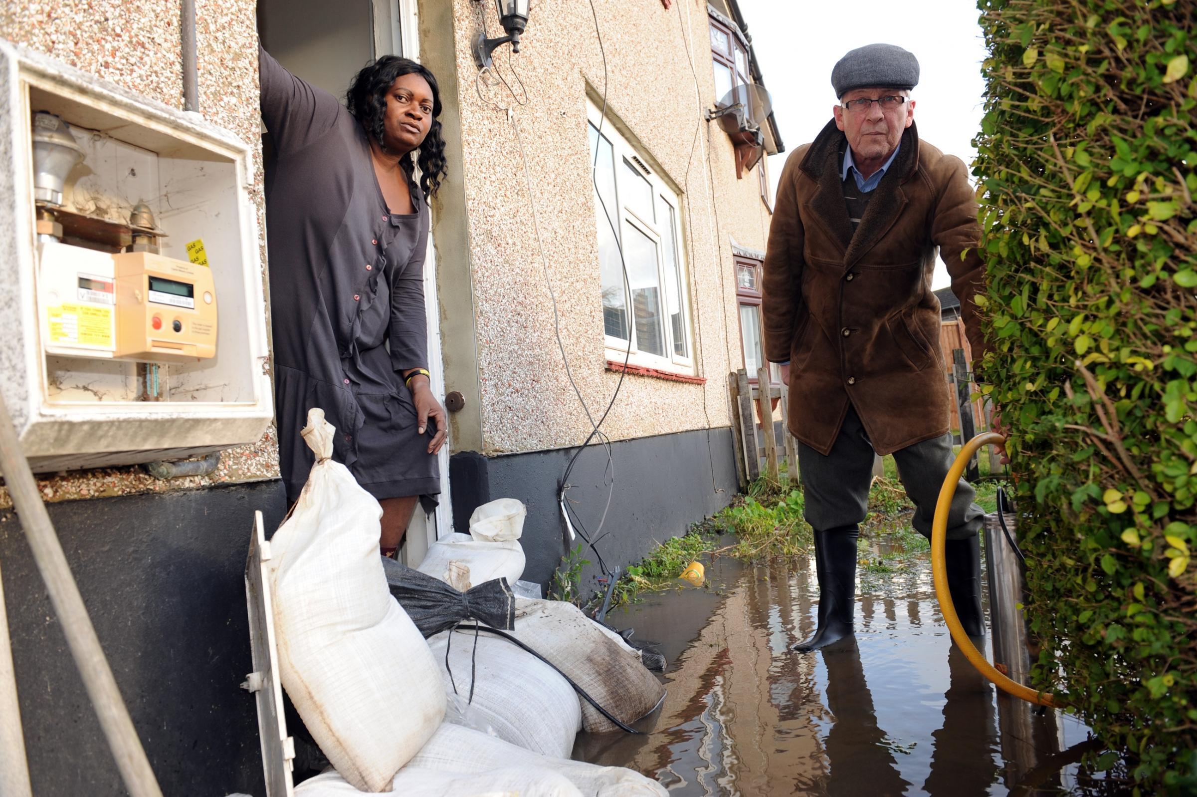 John Battie with his wife Juliet outside their flooded Tilbury home