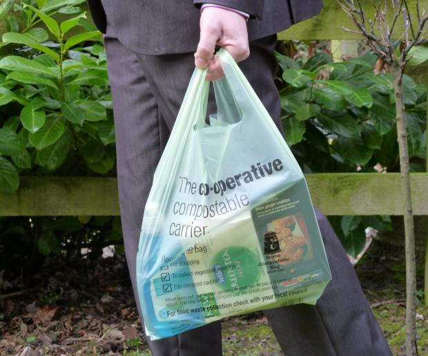 People shopping at Co-op will be able to carry their items home and then re-use the bags as bin-liners in their food waste caddy