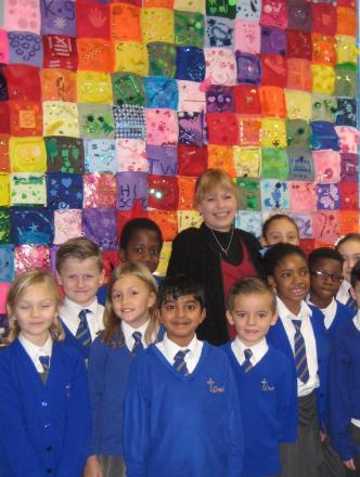 Pupils at the school with headteacher Lallie Godfrey