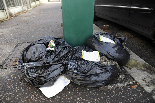 Bin bags are are left uncollected because refuse vehicles are being blocked by illegally parked cars.