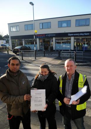Sid Rahman, Tesco deputy manager, left, with customer assistants Emma Holland and Terry Brookes with their petition outside the Southend Road store