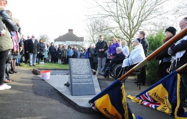 More than a hundred people gathered at the High View Memorial Gardens on Monday morning to mark International Holocaust Day.