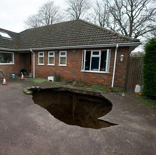Thurrock Gazette: The home of Phil and Liz Conran, High Wycombe, after a 30ft-deep sinkhole opened up in the driveway and swallowed their car