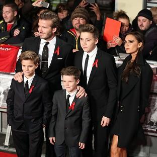 David and Victoria Beckham with their children Brooklyn, Romeo and Cruz