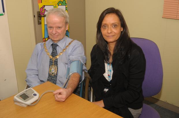 Thurrock Gazette: Mayor Councillor Tony Fish having his check up with Christine Smith from Vitality