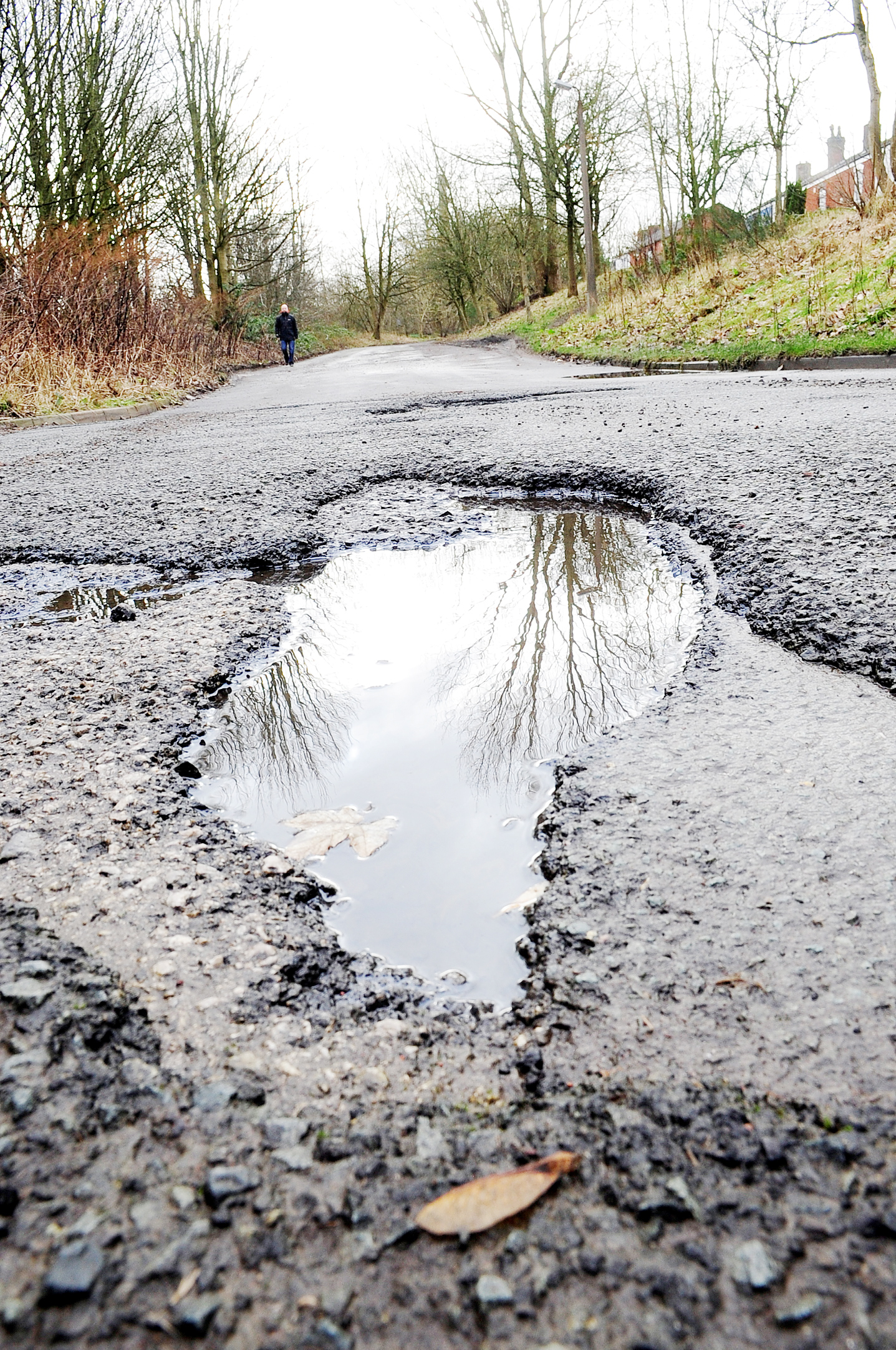 The council says it needs more money to sort out pot holes.