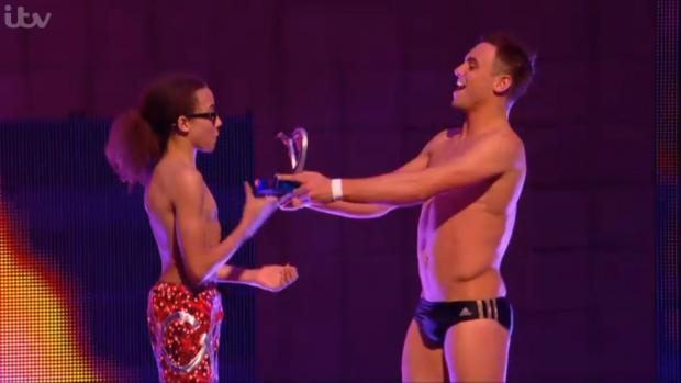 Thurrock Gazette: Perri presented with the trophy by Tom Daley