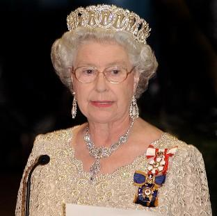 Thurrock Gazette: The Queen welcomed famous names such as John Hurt, Sir Roger Moore and Joan Collins to Buckingham Palce