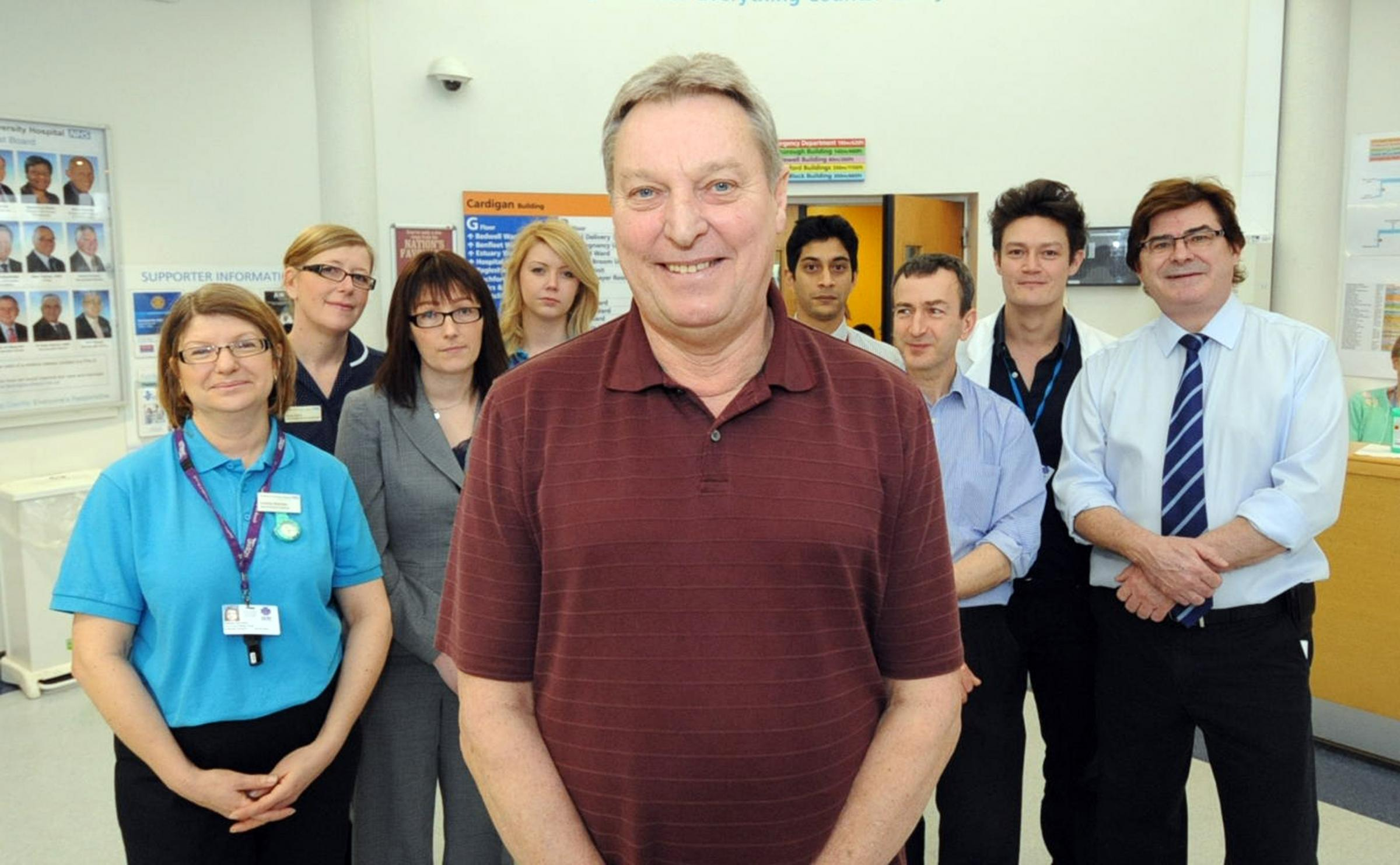 Tony Richards, centre, with hospital staff who saved his life