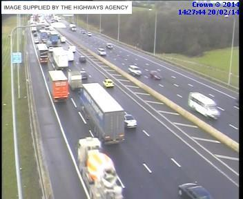 A Highways Agency traffic camera showing slow moving traffic heading