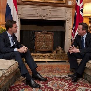 Thurrock Gazette: Prime Minister David Cameron (right) talks with the Prime Minister of the Netherlands Mark Rutte at Chequers