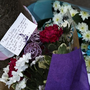 Flowers laid at the site of the double murder in Leytonstone