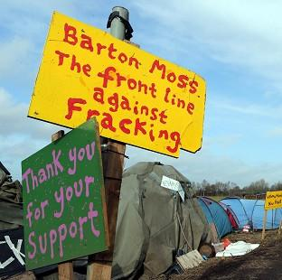 Thurrock Gazette: Protest signs at Barton Moss, Greater Manchester
