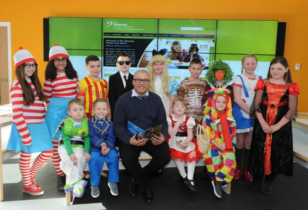 New chapter – headteacher Thom Martin with some of the pupils dressed for Book Day