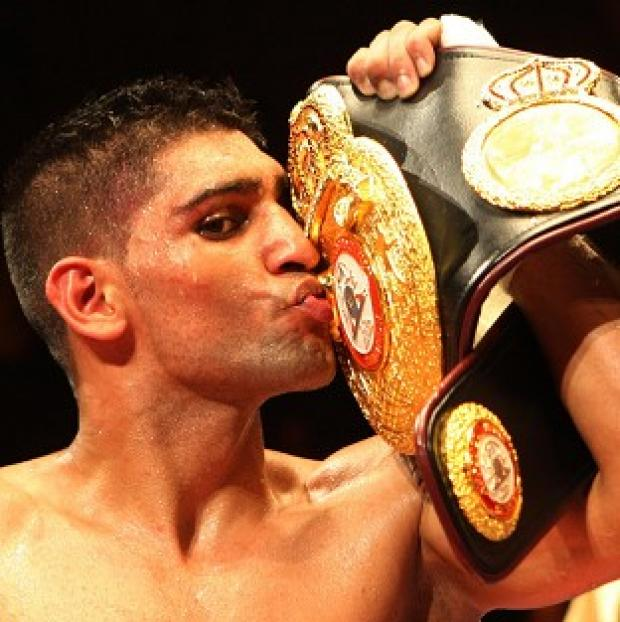 Thurrock Gazette: Champion Amir Khan said he would not allow his son or daughter to become a boxer