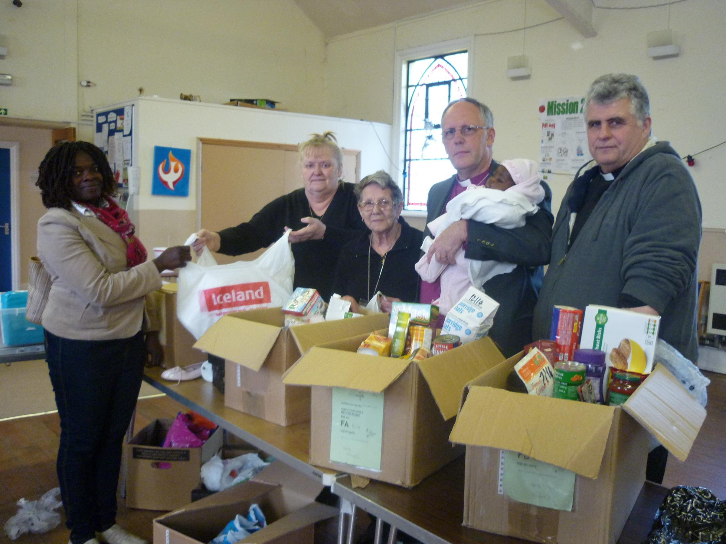 L-R Rita Booh (Food Bank Client), Lynn Mansfield (Volunteer), Iris Holland (Volunteer), Bishop John Wraw and Revd Andy Hudson (Vicar of St Stephen's church).