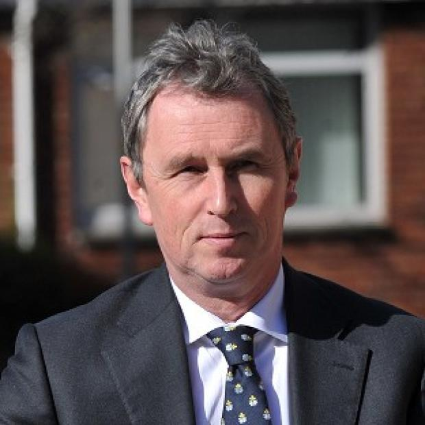 Thurrock Gazette: Former deputy speaker of the House of Commons Nigel Evans arrives at Preston Crown Court where he faces nine charges of sexual offences against seven men