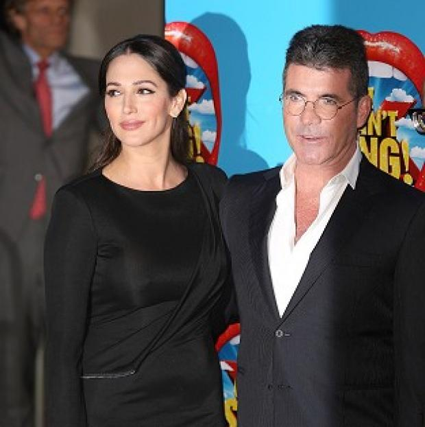 Thurrock Gazette: Lauren Silverman and Simon Cowell attending the opening night of I Can't Sing! The X Factor Musical