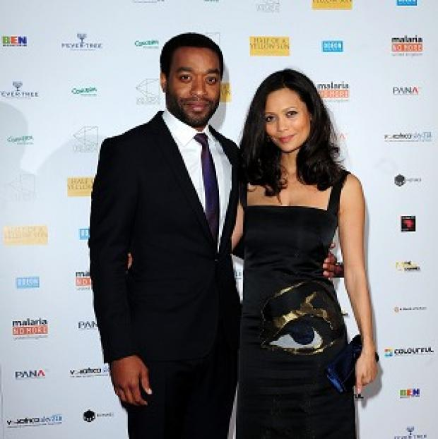 Thurrock Gazette: Chiwetel Ejiofer (left) and Thandie Newton attending the premiere of Half of A Yellow Sun at the Odeon Streatham, London.