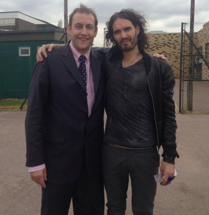 Back home - Russell Brand with school head James Howarth