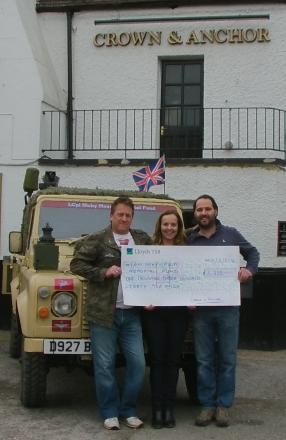 Dennis Mason (L) with pub landlords Michael and Tanya.