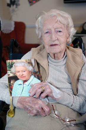 Constance on her 100th birthday, with her card from the Queen