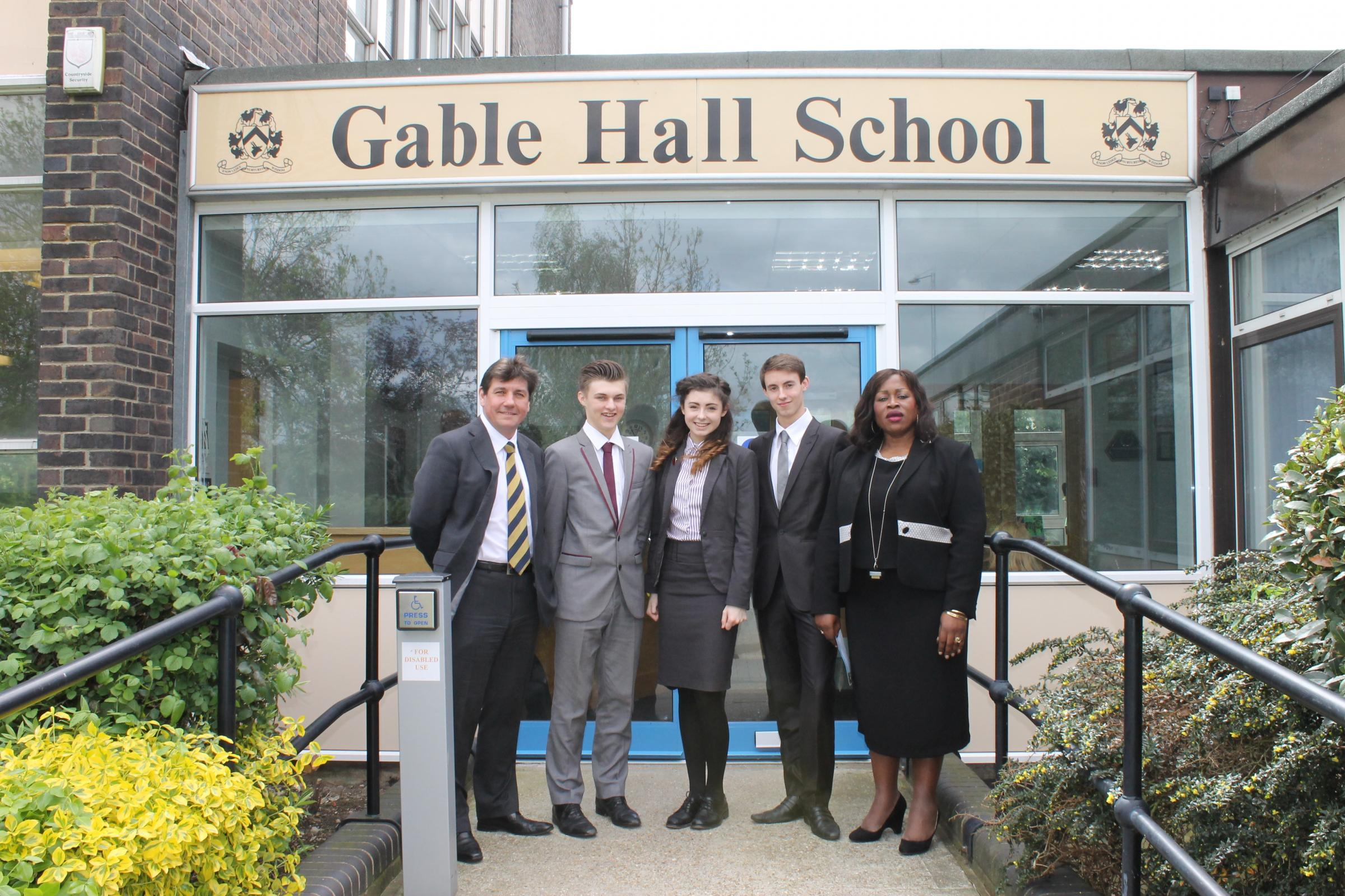 Stephen Metcalfe with senior pupils and headteacher Dr Sofina Asong